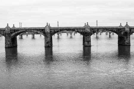 crystallize: Black and white crystallize crossing bridge city of Harrisburg in Pennsylvania during gloomy and cloudy day