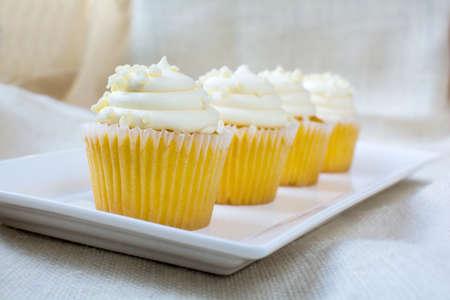 vanilla cupcake: Four french vanilla cupcakes and creamy vanilla icing with white chocolate bite topping. Vanilla cupcake dessert