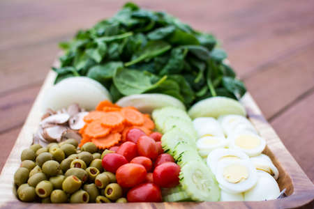 vegetable tray: Fresh vegetable salad in wooden tray
