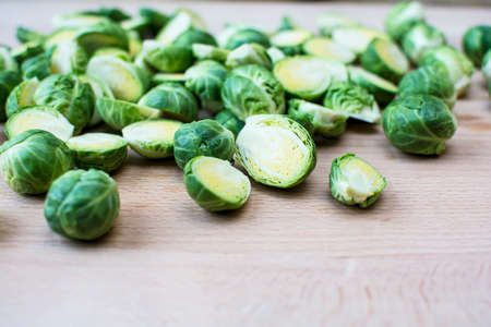 Fresh cut brussels sprout on wooden board with some spaces for words or texts, Selected focus brussels sprout on wooden cutting board
