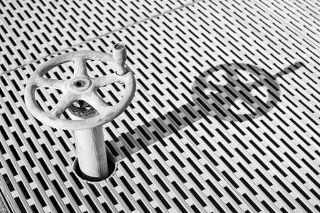 Old dusty metal wheel with pattern background Archivio Fotografico