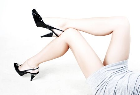 fetishes: Beauty legs of young woman on white background Stock Photo