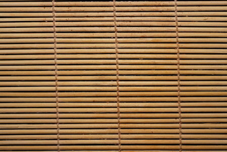 bamboo stick: brown natural wickerwork background from bamboo stick Stock Photo