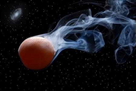 enveloped: orange enveloped by smoke on a black background