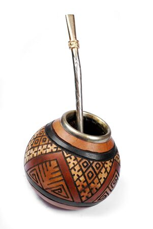 dried gourd: calabash with ethnic ornament and metal straw Stock Photo