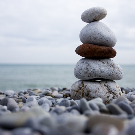 cairn: cairn of stone at the beach of the sea