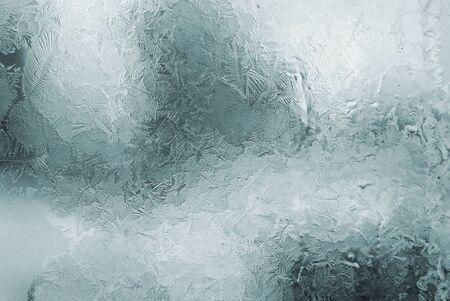 frosted window: blue winter frosted window with beautiful tracery Stock Photo