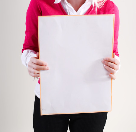 a placard: Woman takes placard at white background