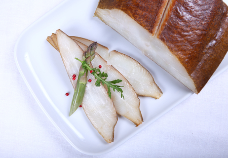 condiment: Fresh white fish decorated with salad and condiment. Close-up Stock Photo