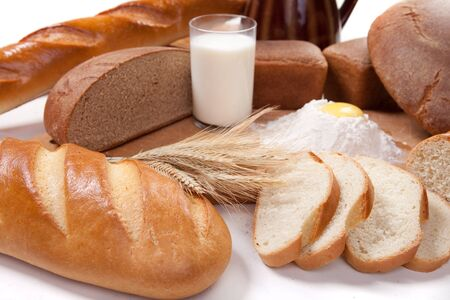 breadboard: Fresh bread bakery products with eggs and flour on the breadboard