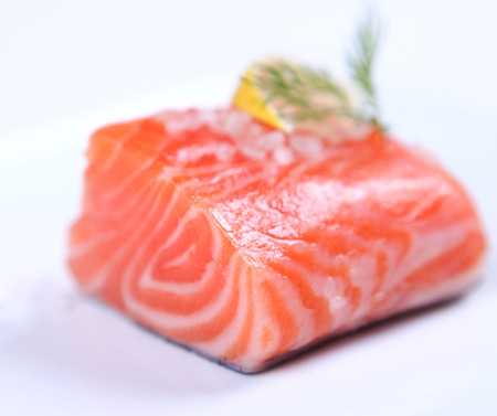 red salmon: Raw fresh red salmon at white plate