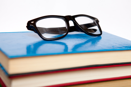 bibliophile: A lot of books for studying and black glasses