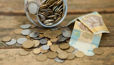 ukranian: A lot of ukrainian coins and hryvnas showing poverty in Ukraine