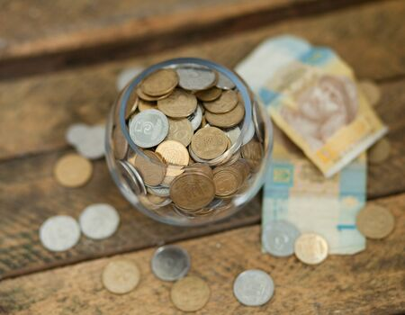 hryvna: A lot of ukrainian coins and hryvnas showing poverty in Ukraine