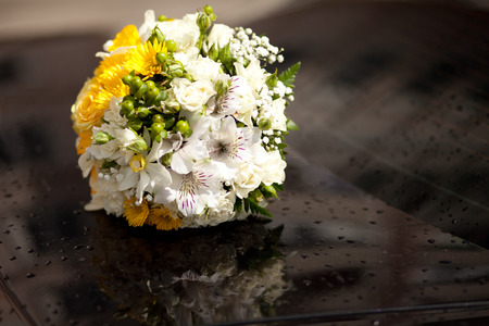 nosegay: Beauty wedding bouquette of flowers at the black back of car Stock Photo