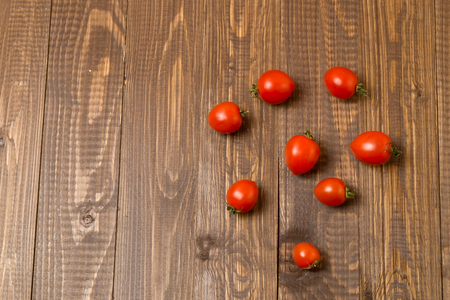 Just plucked red cherry tomatoes are on the table