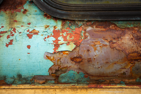 chipped paint: Close-up view of old damaged metal wall with chipped paint and corrosion