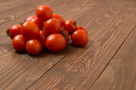 Fresh red cherry tomatoes are on the table