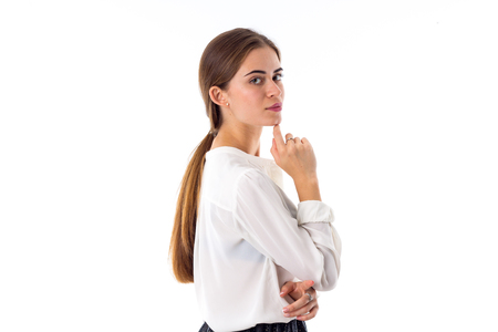 ponytail: Young attractive woman in white blouse with long pony-tail on white background in studio Stock Photo