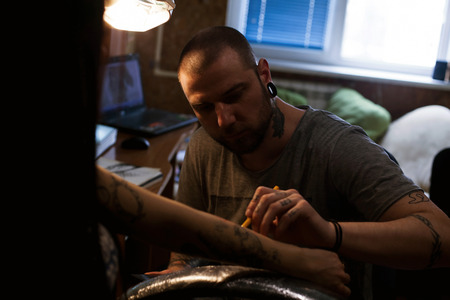indelible: The tattoo artist is preparing the area that will be tattooed