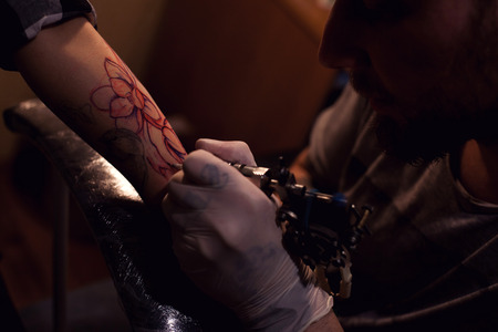 indelible: Painful procedure of getting tattoo from professional tattoo artist