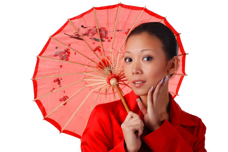 beautiful woman in red autumnal cloak with parasol