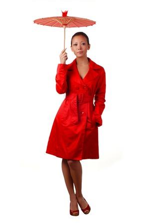 cloak: beautiful woman in red autumnal cloak with parasol