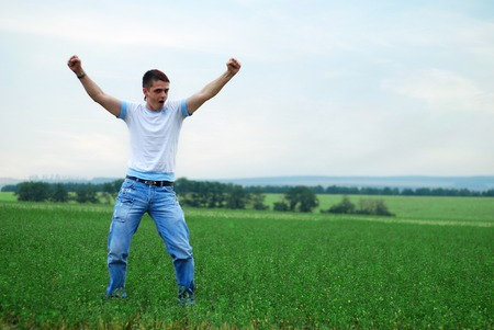 human energy: happy young man have a good time on the green grass