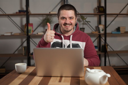 okey: Man shows that everything is okey at the table Stock Photo