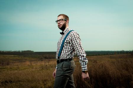Redneck nerd man in glasses with beard outdoor