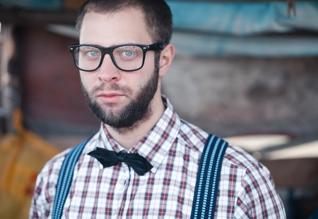 Redneck nerd man in glasses with beard outdoor