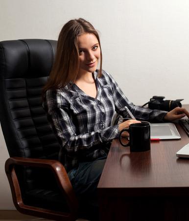 coffe break: Retoucher wants to do her work during coffe break Stock Photo