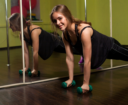 nice body: Young beautiful woman will have nice body after spending her leisure time in the fitness club Stock Photo