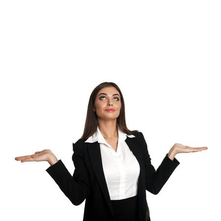 disbelief: Model in business suit shrugging in disbelief in studio Stock Photo