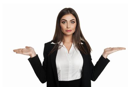 disbelief: Young businesswoman in black suit shrugging in disbelief