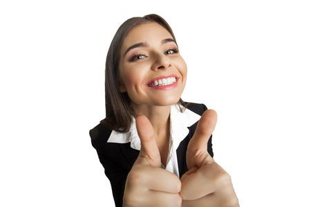 businesswoman suit: Happy businesswoman in black suit showing It`s very good