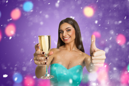 very good: Attractive model with glass of champagne showing it`s very good Stock Photo