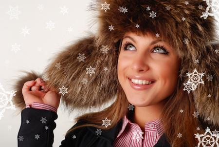 beautiful woman in fur cap with ear flaps and bubos