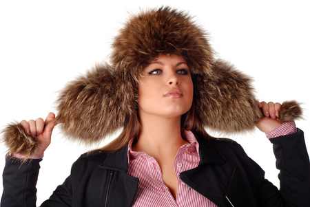 flaps: beautiful woman in fur cap with ear flaps and bubos