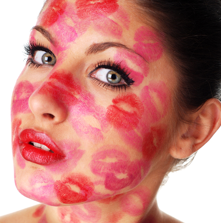 kissing mouth: beautiful woman with stamps of red  lipstick on her face