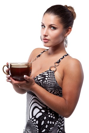 gracefully: Beautiful young woman in summer dress gracefully holding a large cup of tea Stock Photo