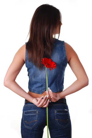 portarit: portarit of a beautiful woman in jeans wear with flower Stock Photo
