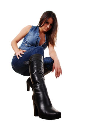 portarit of a beautiful woman in leather boots