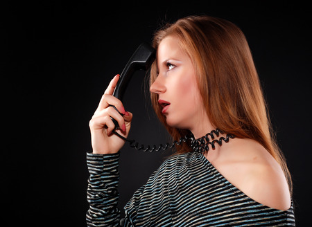 receiver: young beautiful woman with black telephone receiver