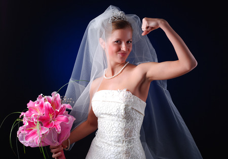 young bride with bouquet of lilys on a black background Stock Photo