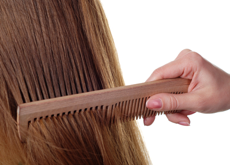 comb: beautiful brown long hair and wood comb Stock Photo