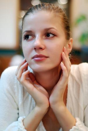 portrait of beautiful woman in white sweater