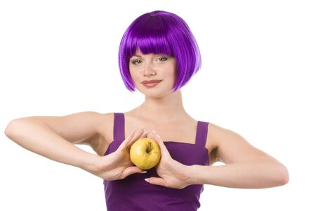 ration: beautiful woman in purple wig and dress with yellow apple Stock Photo