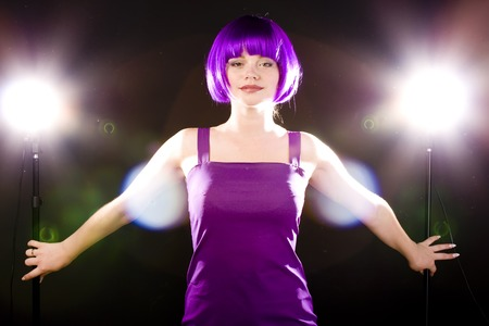 woman in purple wig and dress in bright illumination