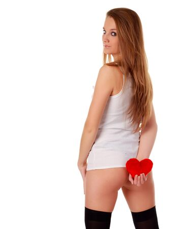 young beatiful woman holding artificial red heart